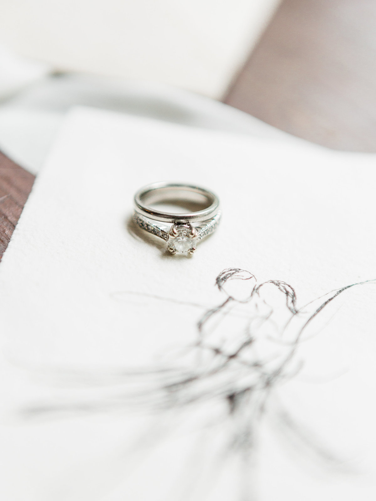 Wedding bands on drawing of dancers Victoria Fiaretti Butler Mansion | Pittsburgh Wedding Photographer | Anna Laero