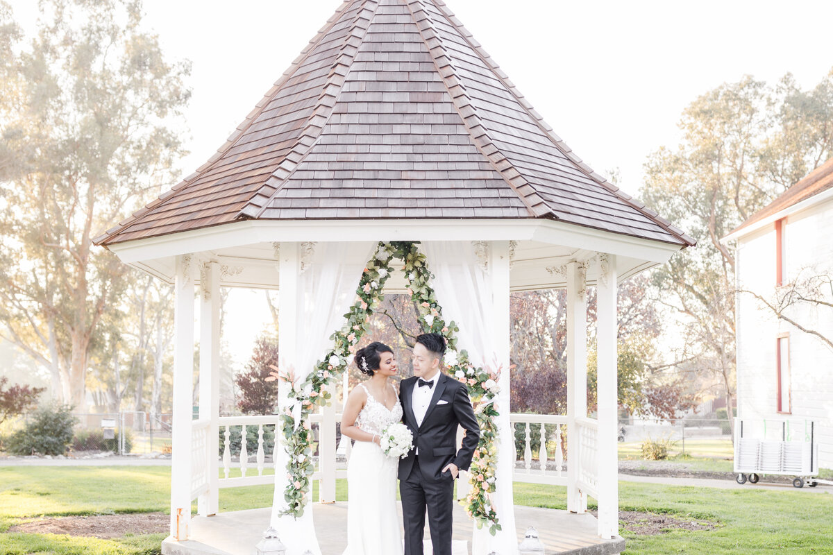 Bride and Groom stand in front of the gazebo at Ravenswood Historic Site in Livermore, CA