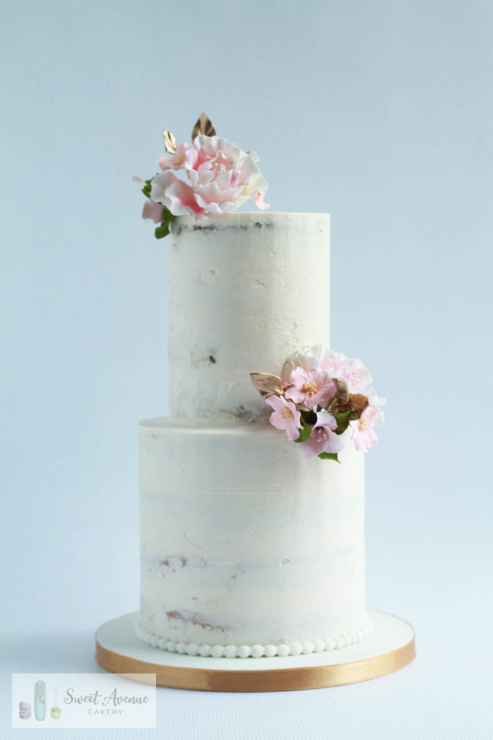 rustic semi naked buttercream cake with flowers, Hamilton ON wedding cakes