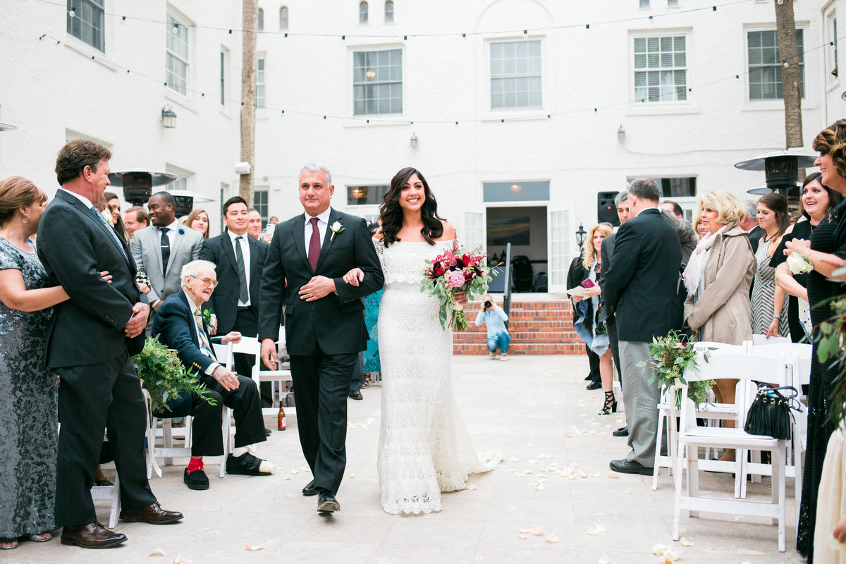 Bride walking down aisle at Casa Marina Wedding Venue in Jacksonville