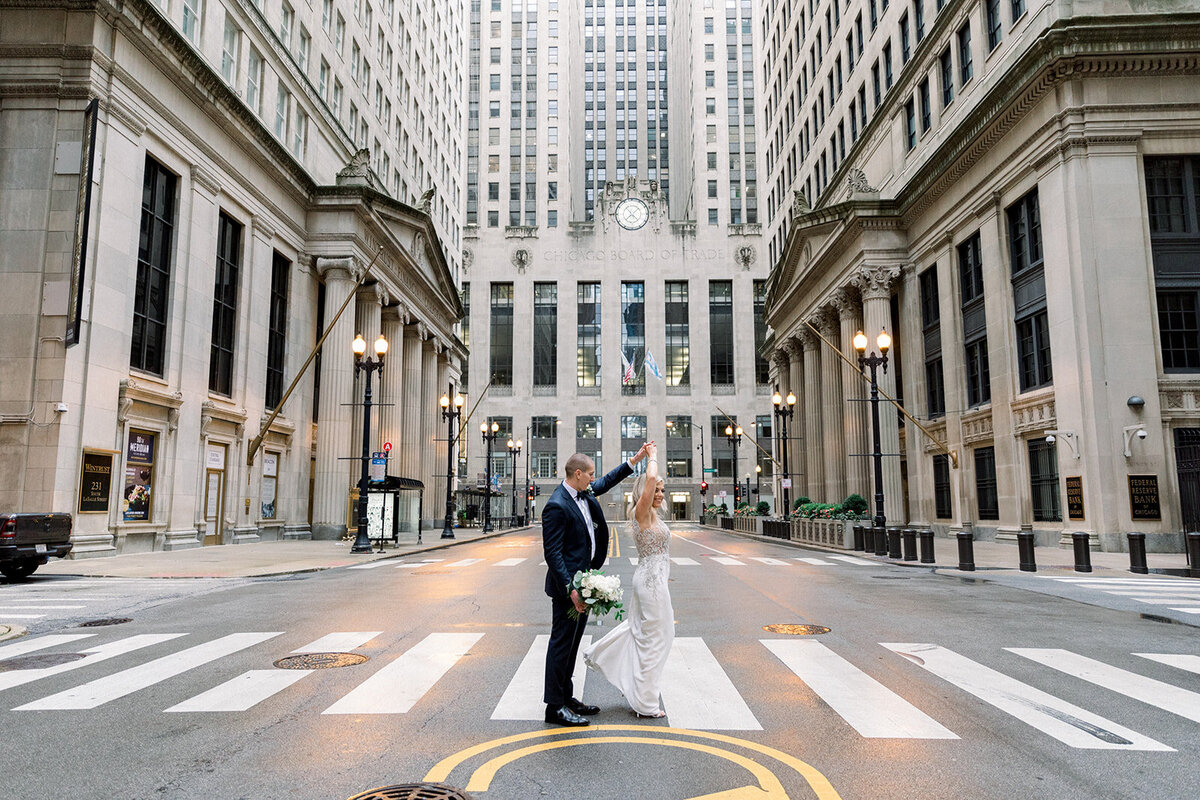 bride and groom dance in front of chicago board of trade