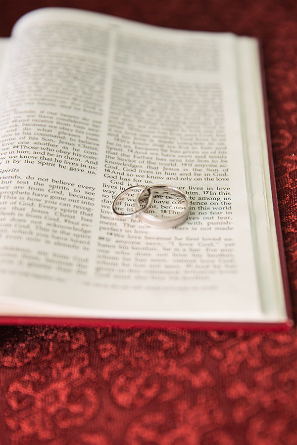 Close up of rings on an open Bible at a wedding