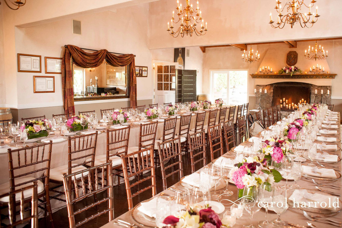 long dinner party tables lined with flower centerpieces at Chateau Lill