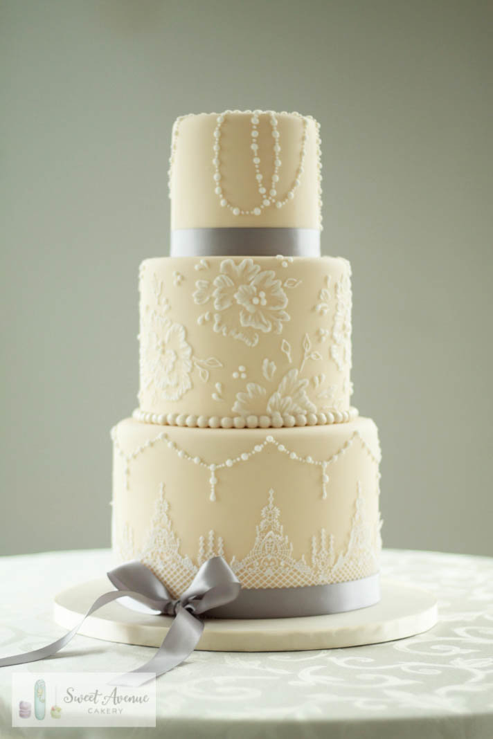 vintage wedding cake with lace and pearls