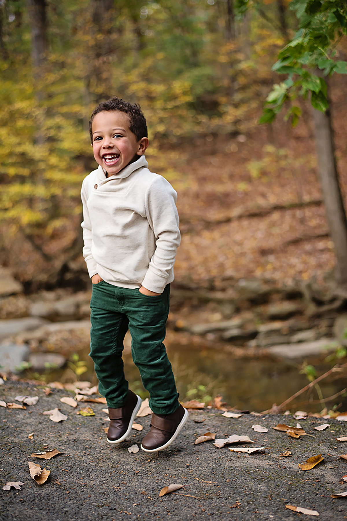 Gorgeous fall photo of happy child at Lubber Run Park in Arlington Virginia by Sarah Alice Photography