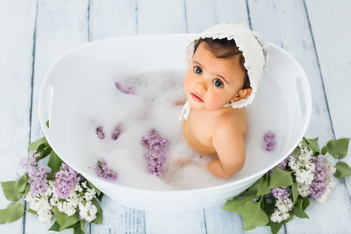 baby girl in tub with bubbles and lilacs {Etobicoke Baby Photographer}