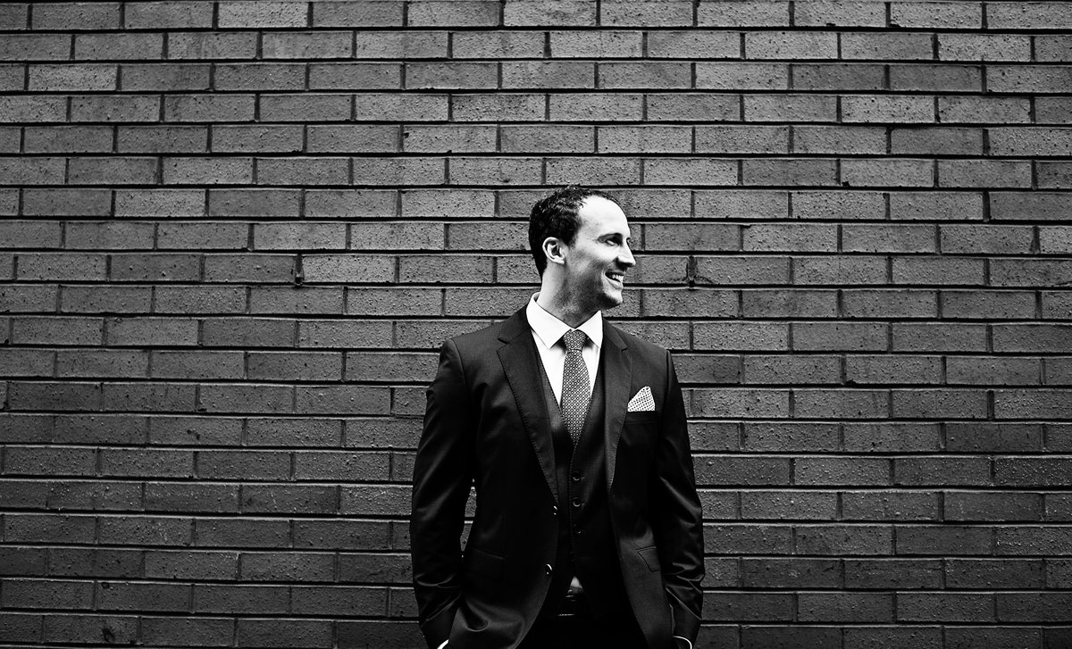 A Groom Waiting at Great John Street Manchester City Center Wedding Photography