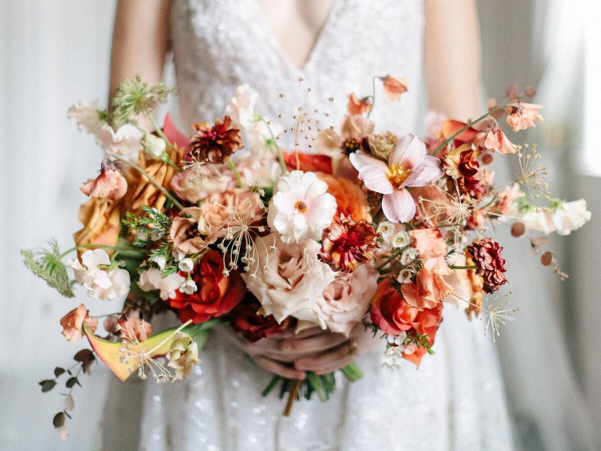 pink, white, red, and orange bridal bouquet flowers
