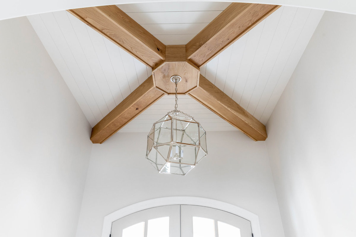 1-White-Shiplap-Ceiling-with-white-oak-x-beam