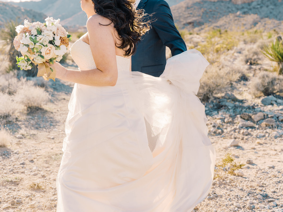 a bride and groom in Red Rock Canyon Las Vegas with a bridal bouquet
