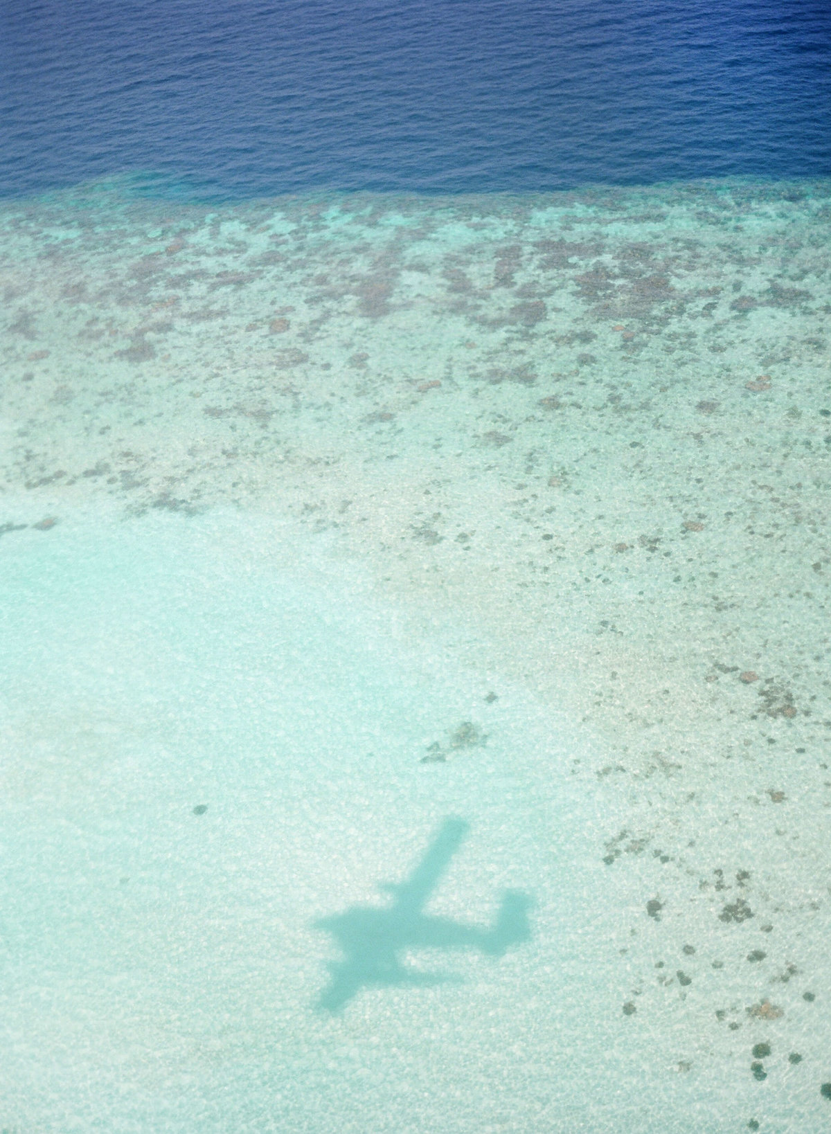 8-KTMerry-airplane-shadow-destinationwedding-Maldives
