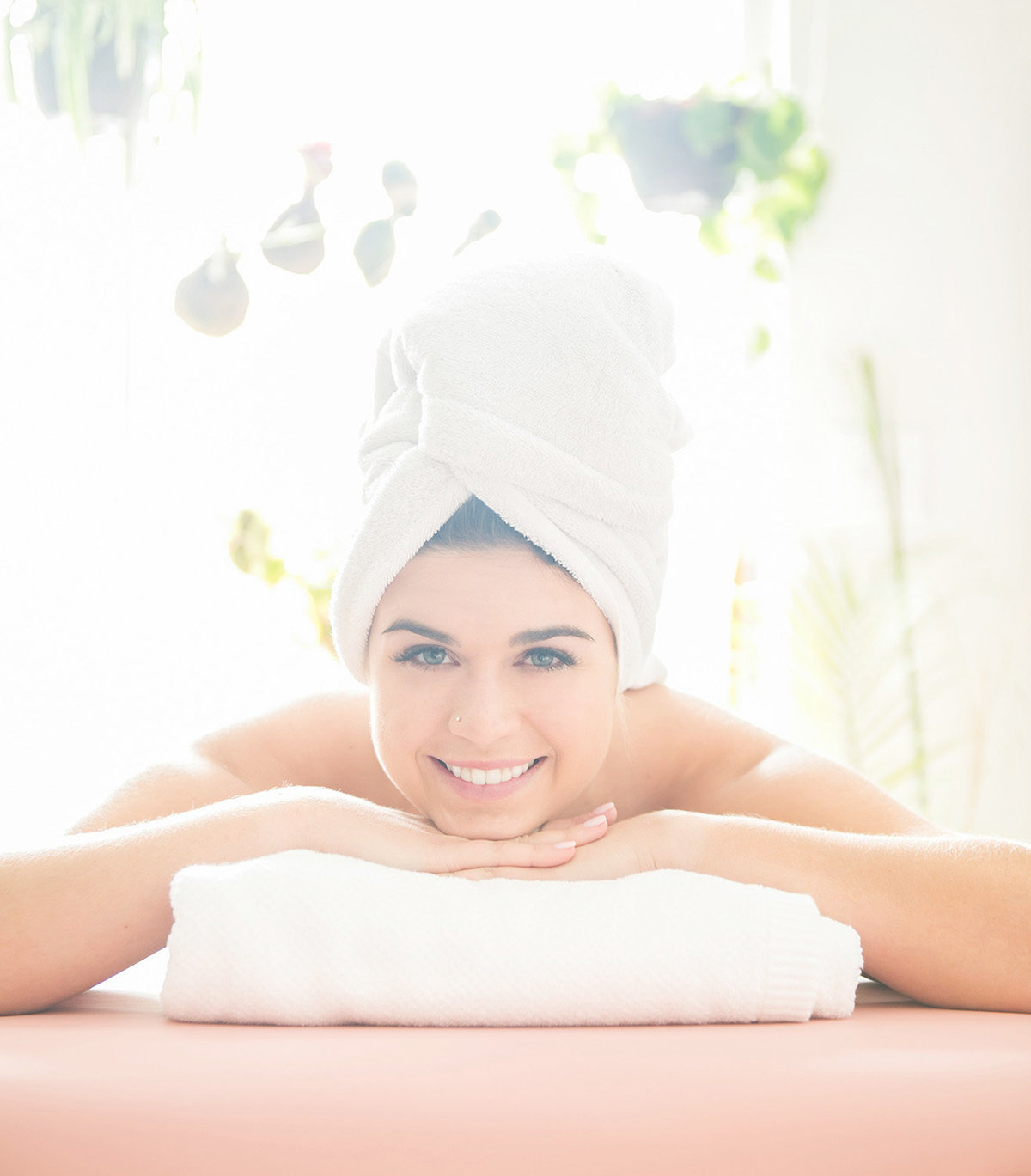 Woman on massage table with towel on head