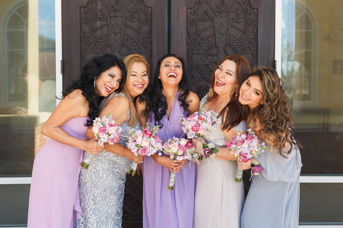 Smiling and Laughing Bridesmaids Pose in Lavender Dresses Outside of St Lukes Wedding in Jacksonville Florida