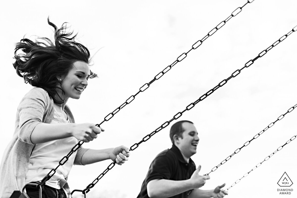 Massachusetts Engagement Session on the swings in the summer