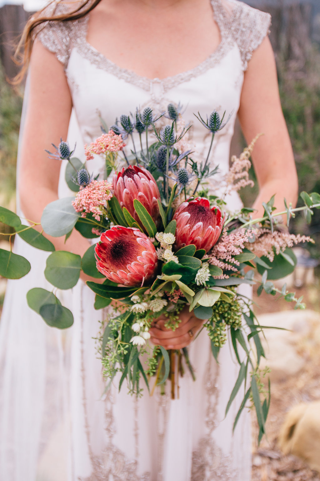 desert inspired pink protea bridal bouquet at wedding in Ojai