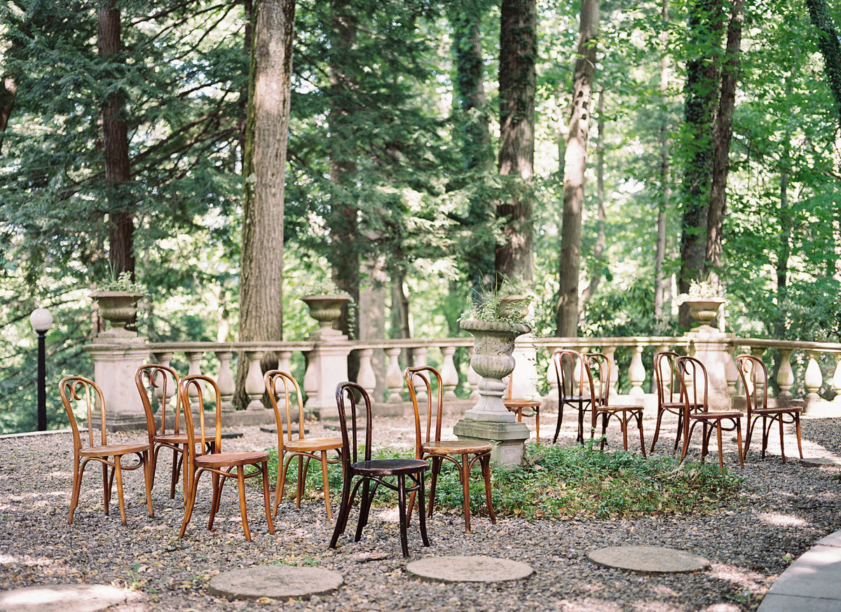 Seating in a wooded patio with dappled light Old Souls Vintage Rentals Butler Mansion | Pittsburgh Wedding Photographer | Anna Laero