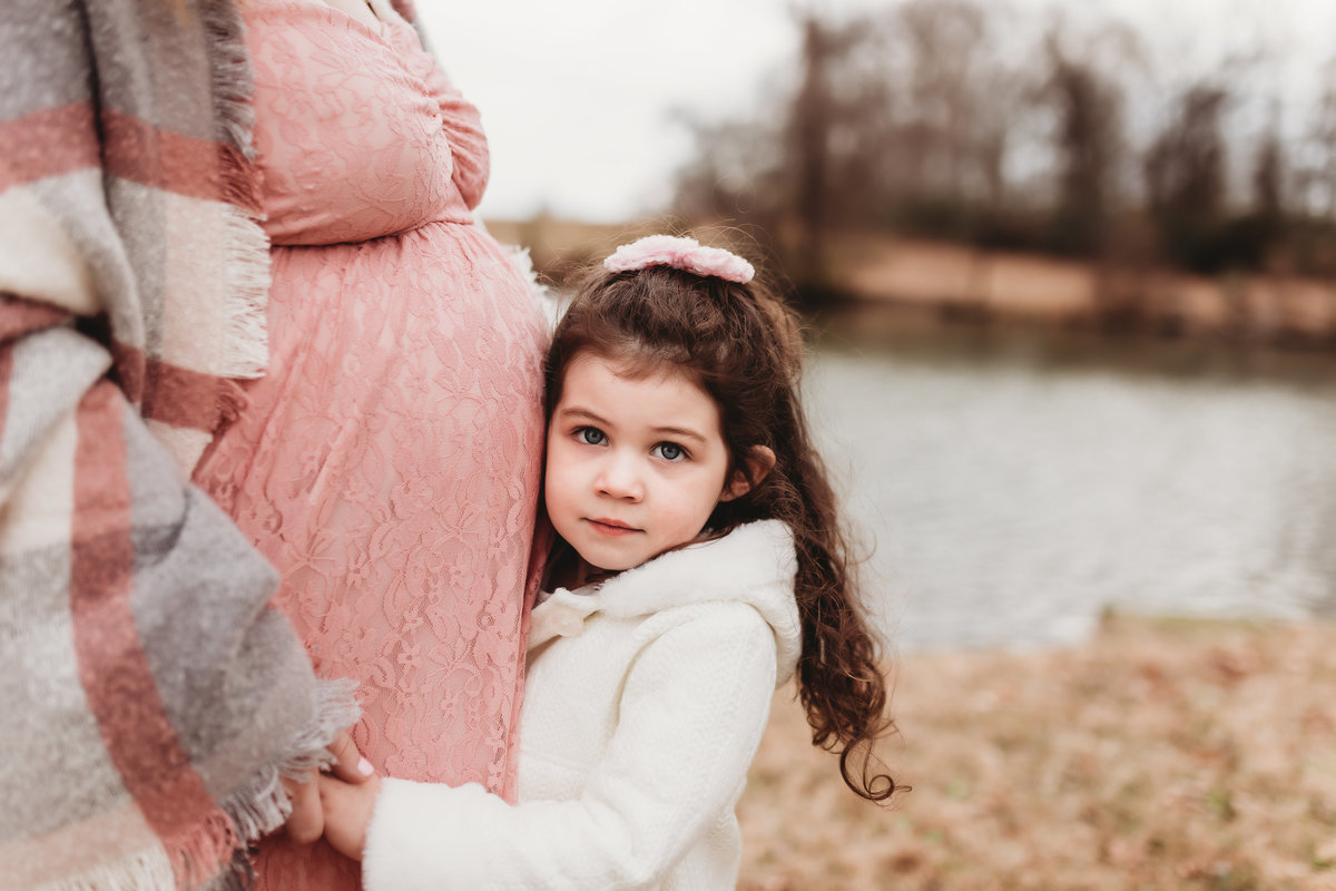 Little girl with mom in maternity photos pink dress winter session