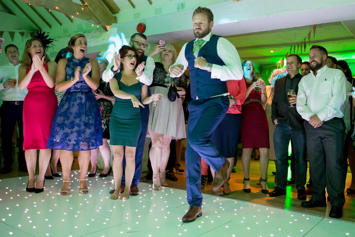 groom dancing photo at bickley mill devon