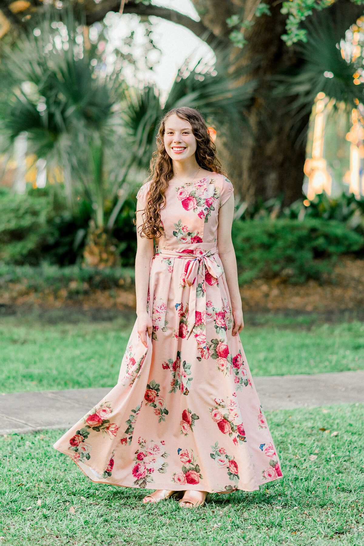 senior girl poses in park in ocean springs