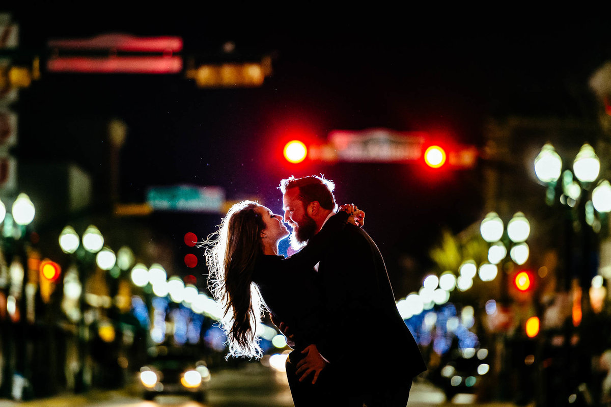 couple kissing at night during their el paso engagement session