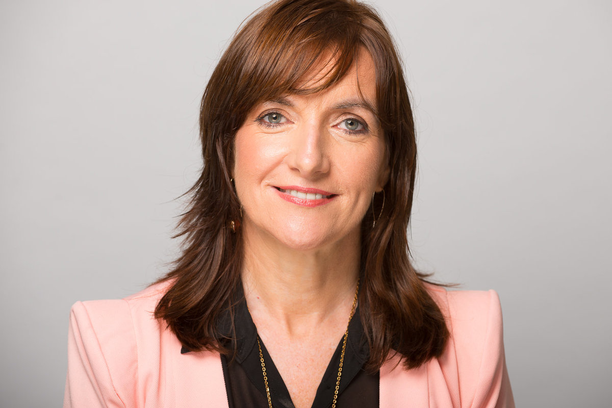 Colour profile pic of a woman for Linkedin wearing black shirt and suit jacket