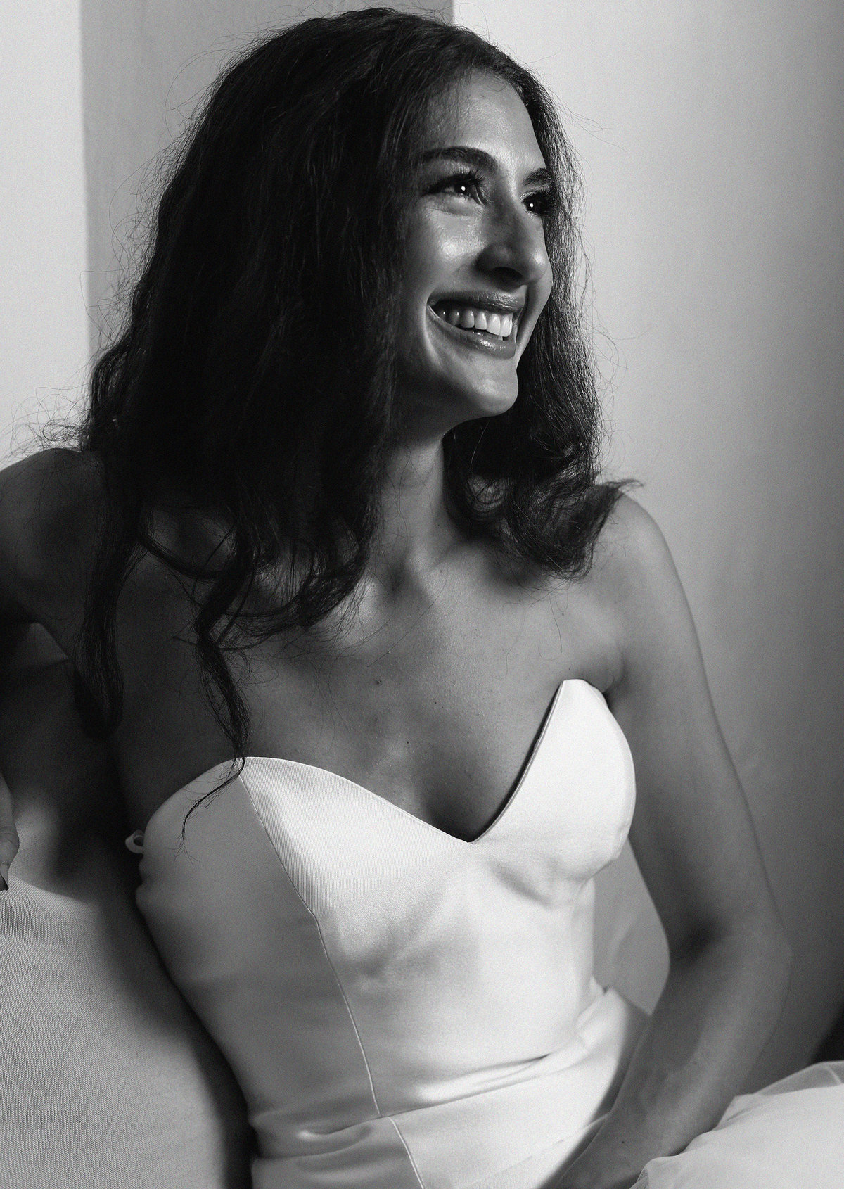 portrait of bride relaxing and smiling before her wedding at Spirit Pittsburgh