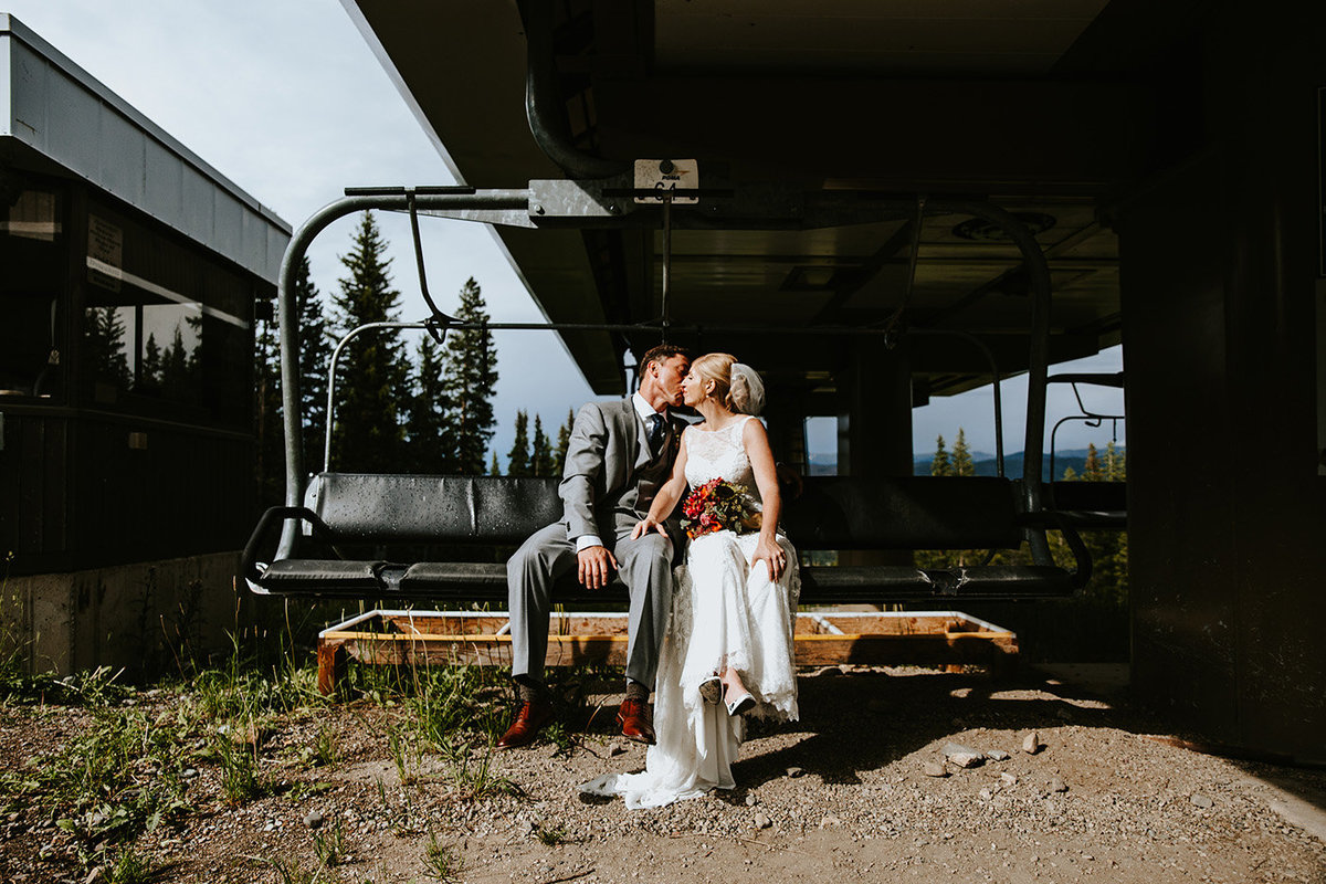 couple on a ski lift at Ten Mile Station in Breckenridge, CO