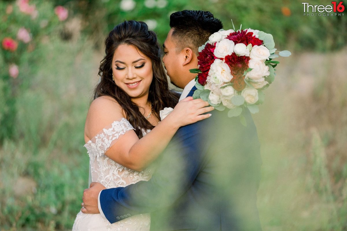 Bride and Groom share intimate moment in the fields of Chino Hills