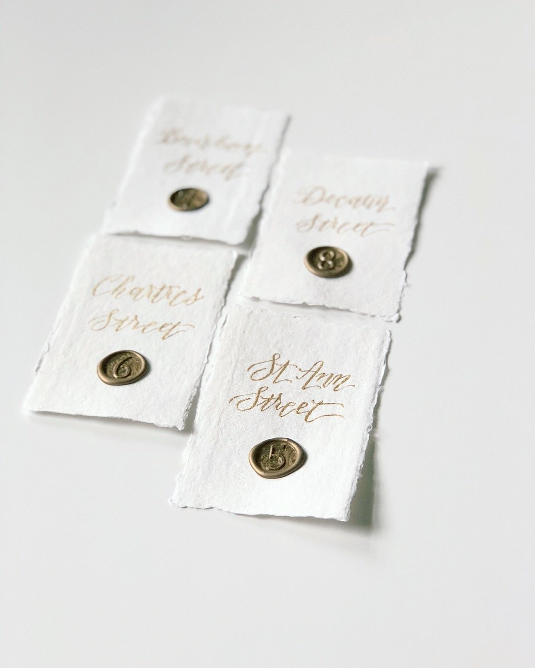 Deckled edge paper with wax seal numbers