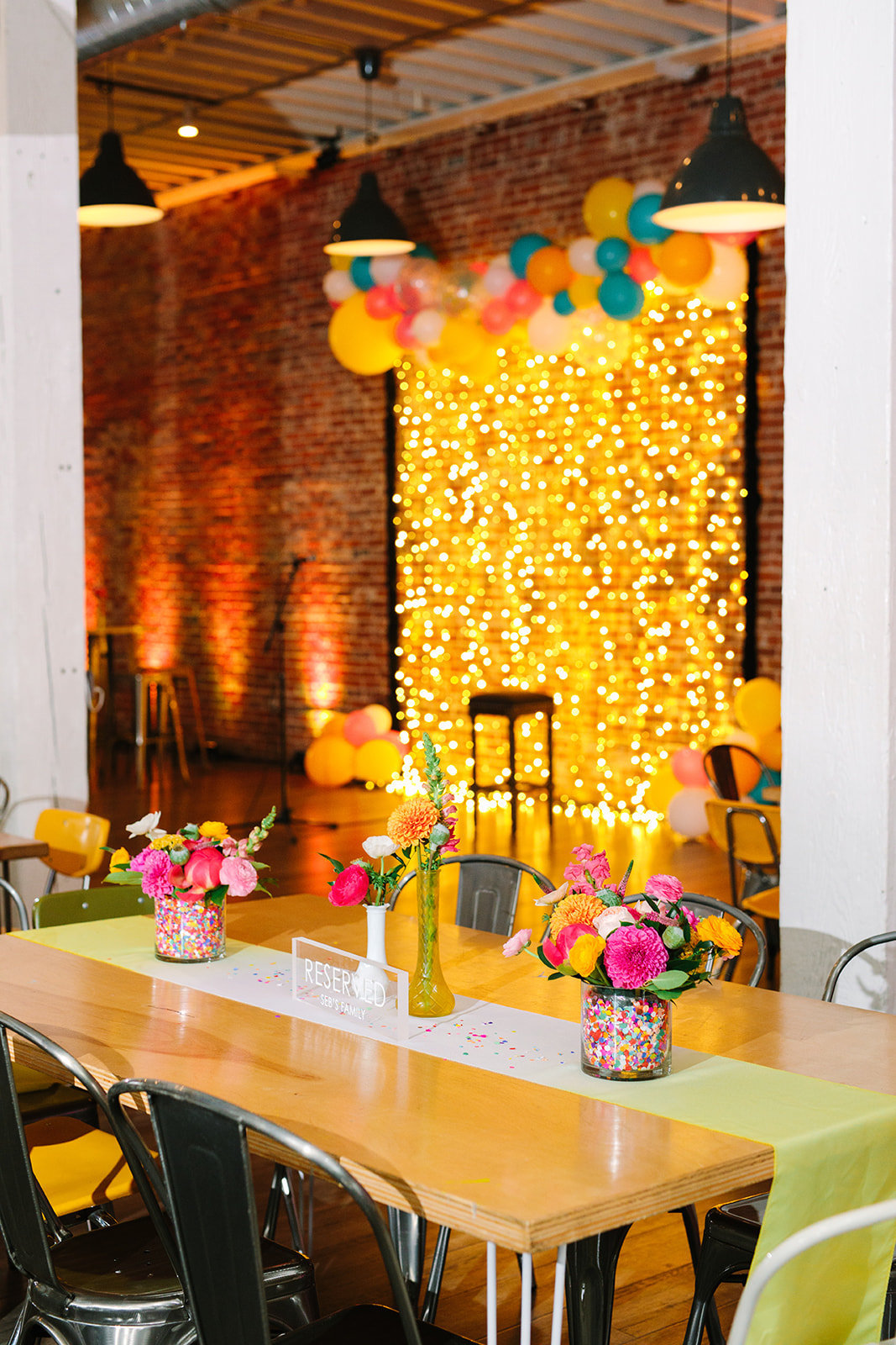 Wedding reception photobooth with string lights and balloons at The Unique Space LA in downtown Los Angeles