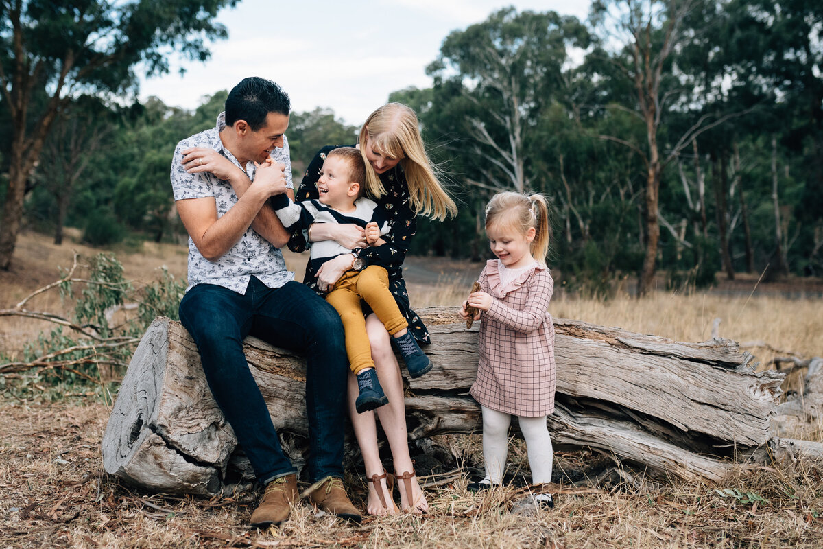 hugging and laughing outdoors Melbourne family photography And So I Don't Forget Photography