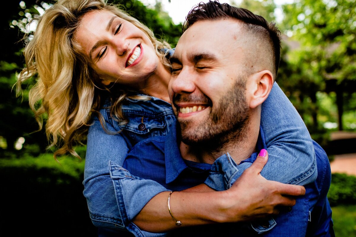 A couple laughs together during a Garden of the Phoenix engagement session.