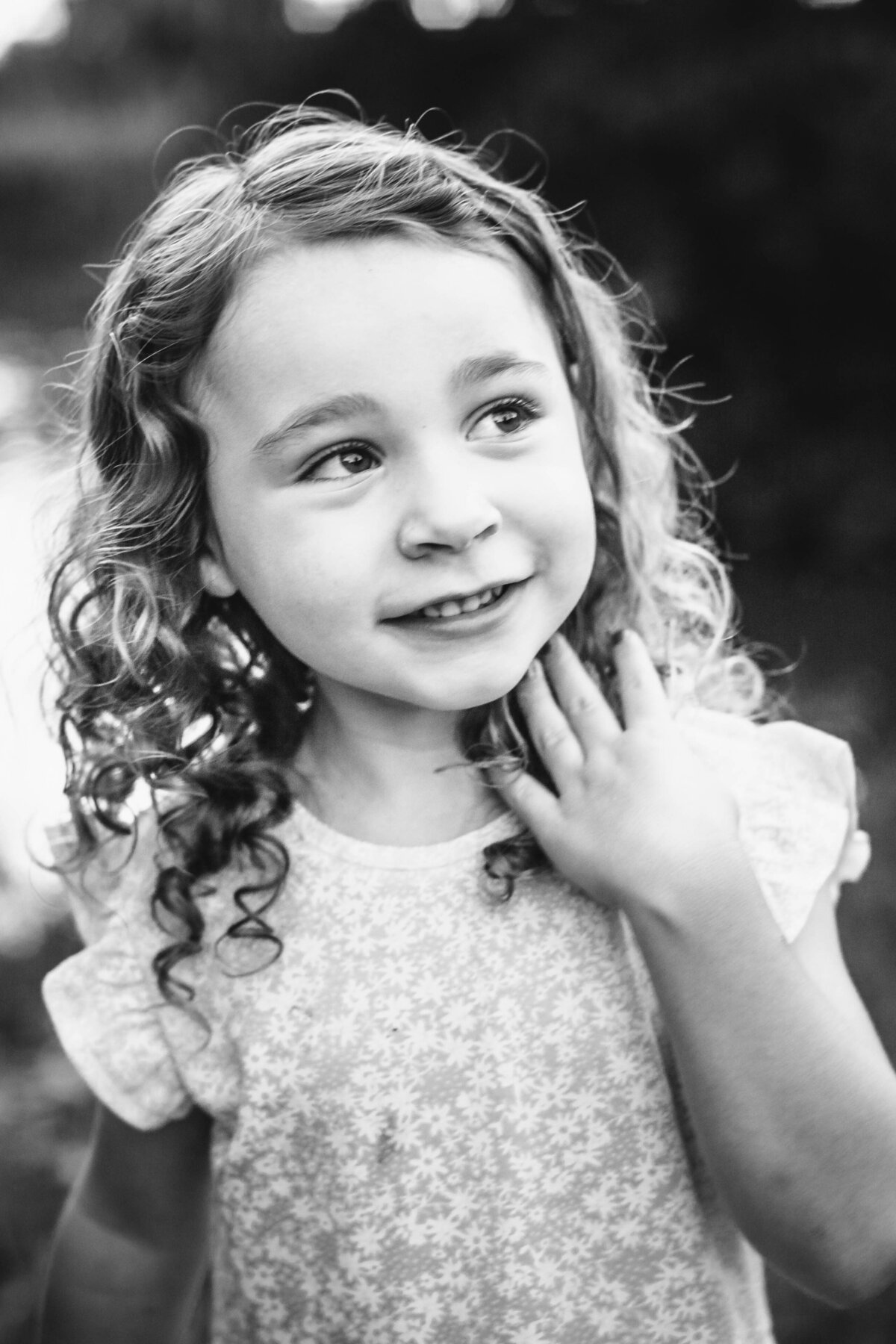 portrait of a girl in black and white gazing up with amazing curly hair