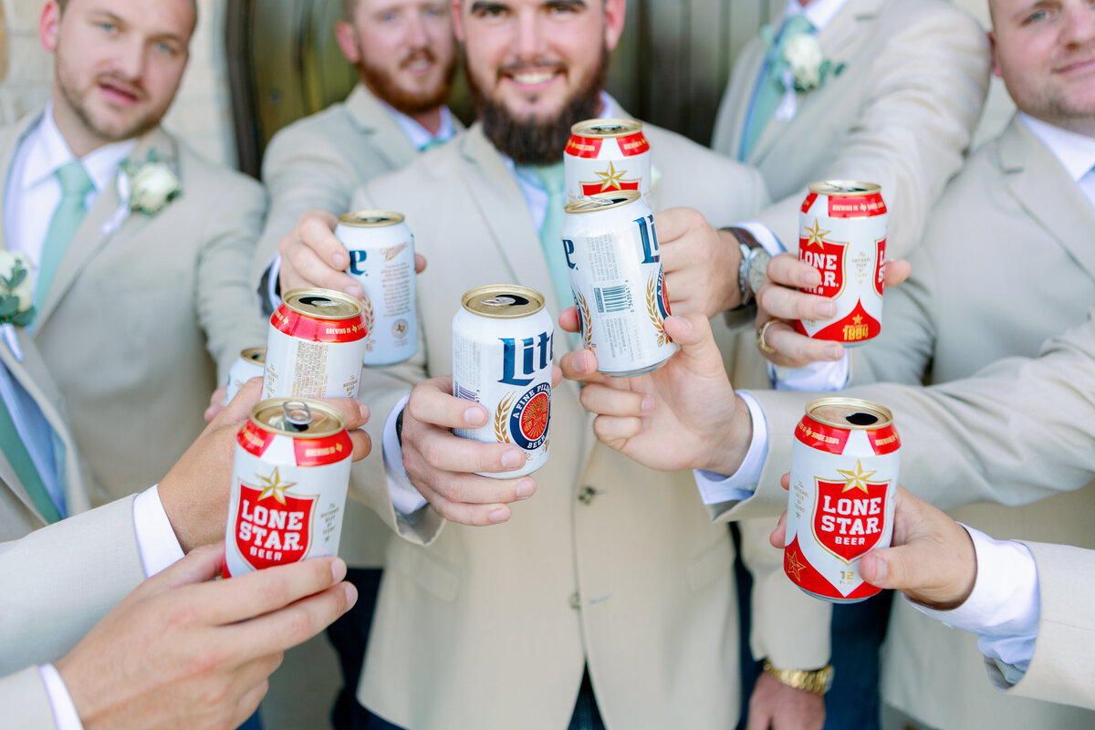 Groomsmen Having a Beer Between Photos