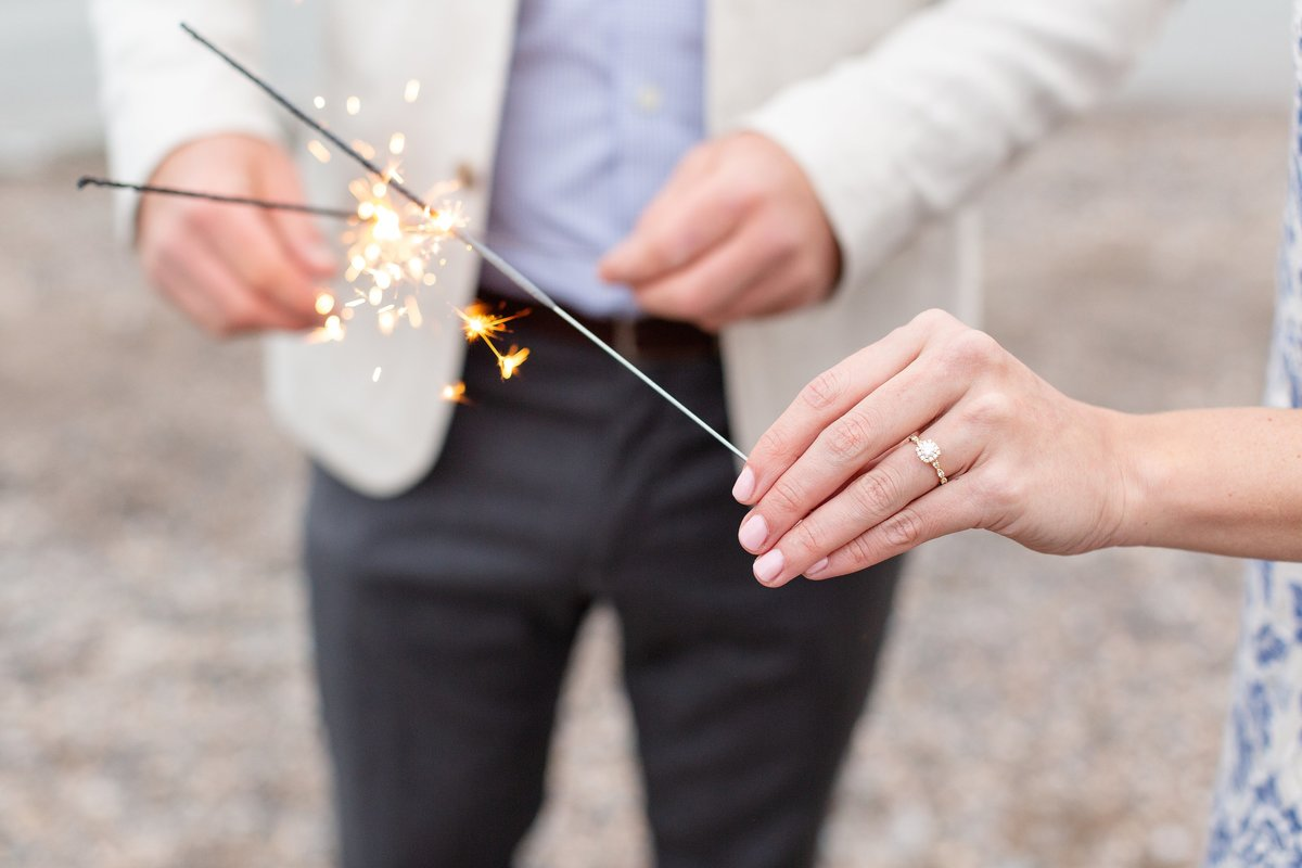 Couple-lights-sparklers-to-celebrate-their-engagement-on-the-beach-at-point-pelee-national-park