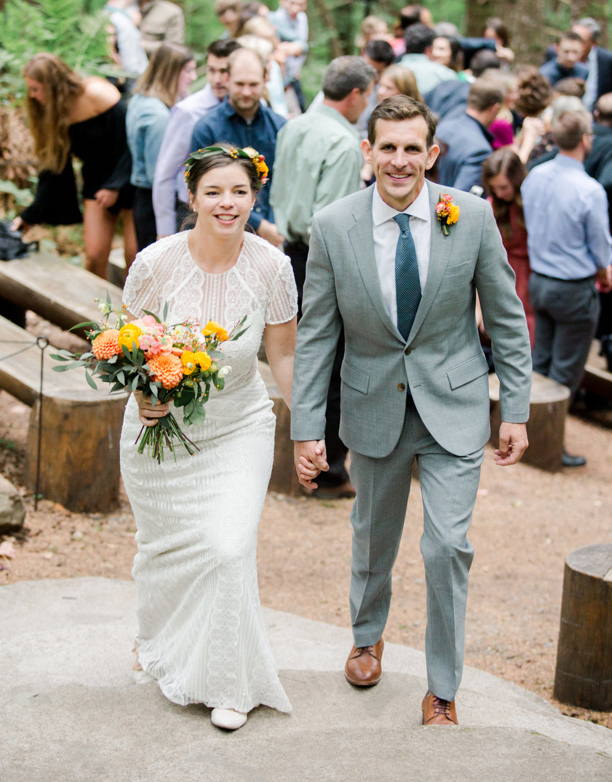 bride and groom just married recessional down the woodland aisle