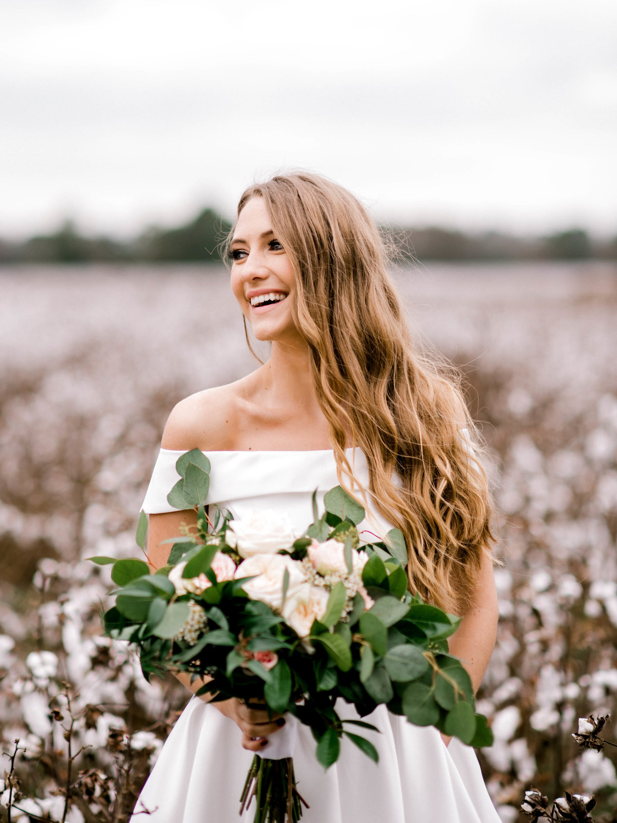 Bride laughing in cotton field Woodlawn Plantation