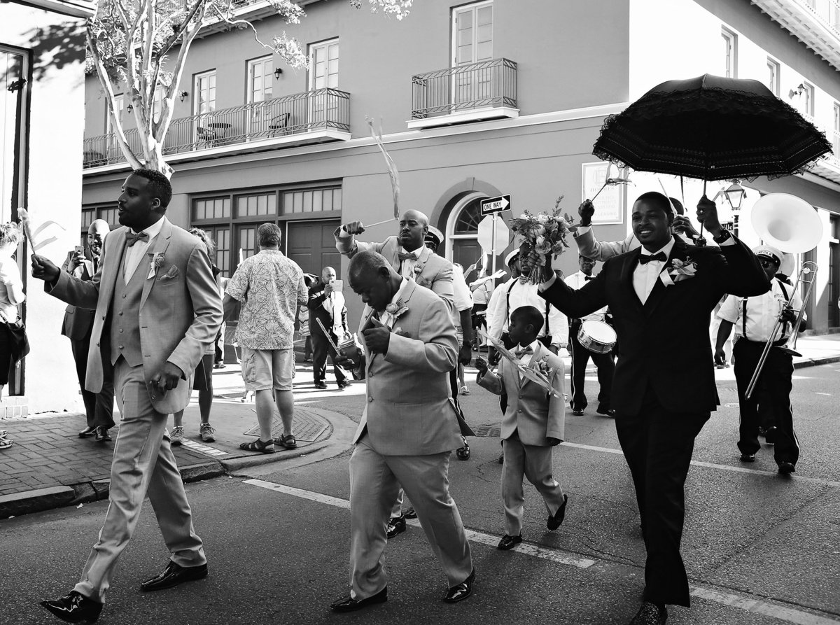 guests walking down the street in wedding second line parade