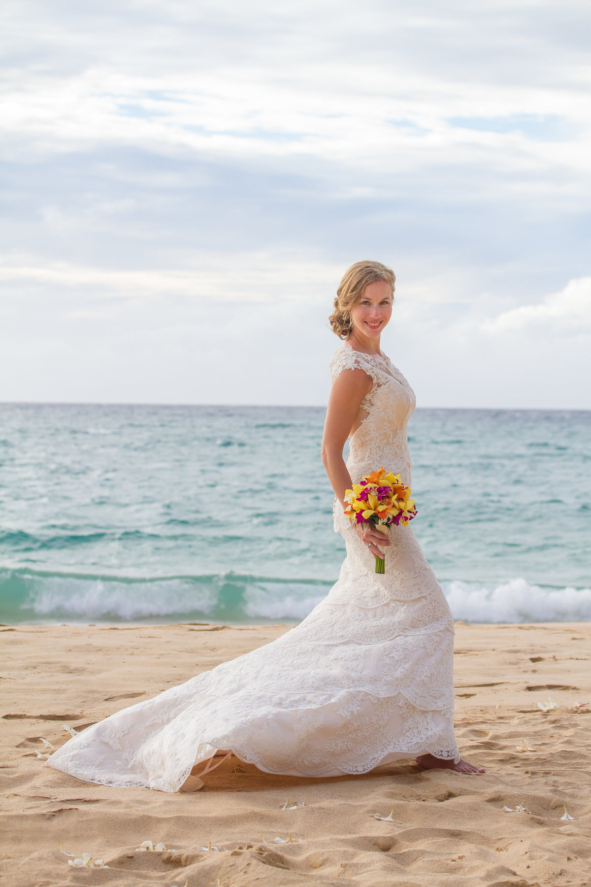 Bride on the beach in Kauai.