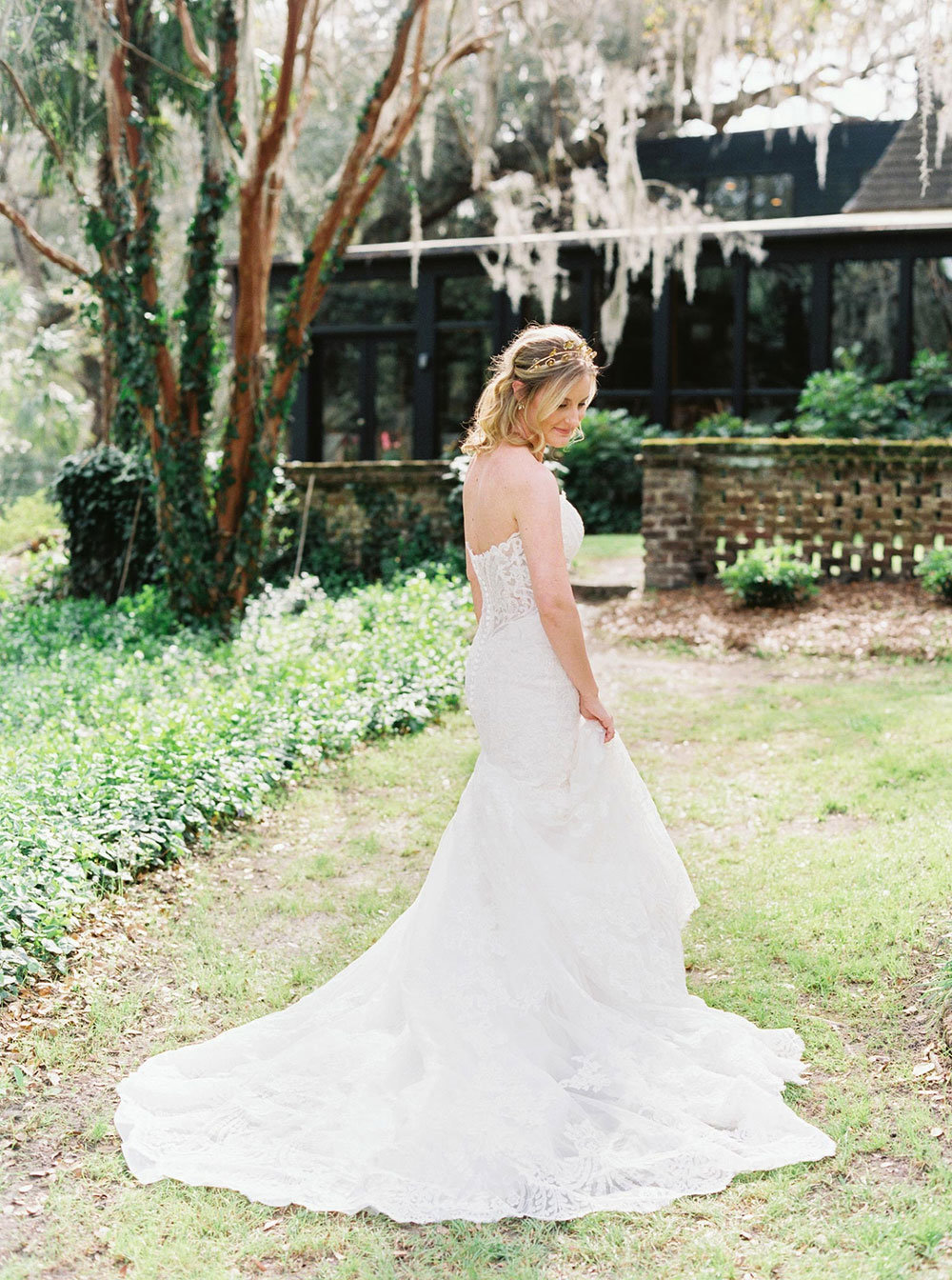 Bride in wedding dress standing on the lawn