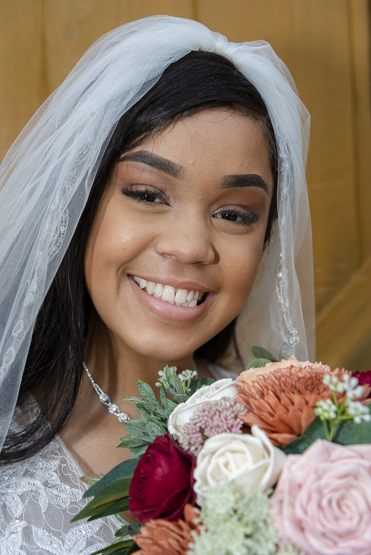 A bride poses with her bouquet for a bridal portrait.
