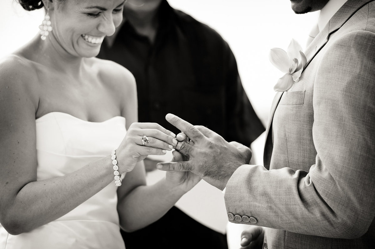 bride putting ring on groom during San Diego wedding