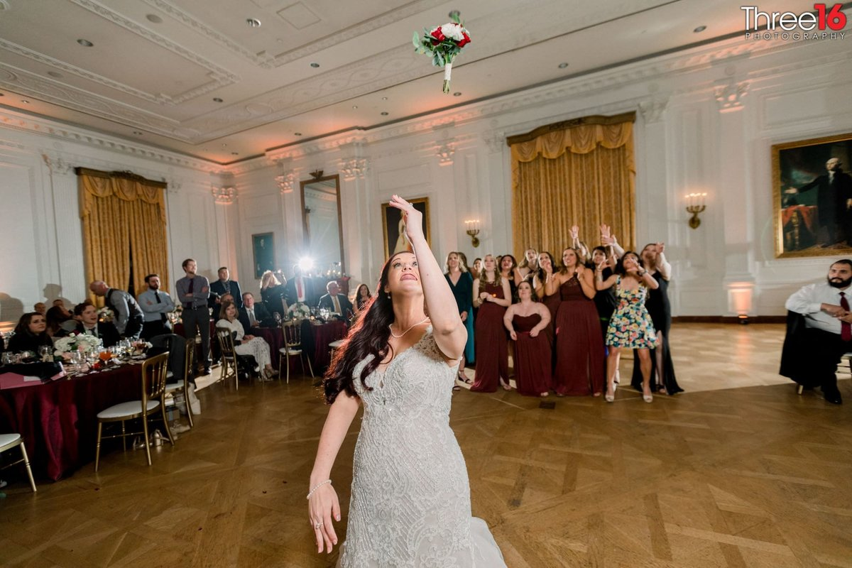 Bride tosses the wedding bouquet