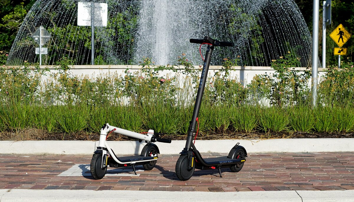 Scoot E-3 by the Water Fountain