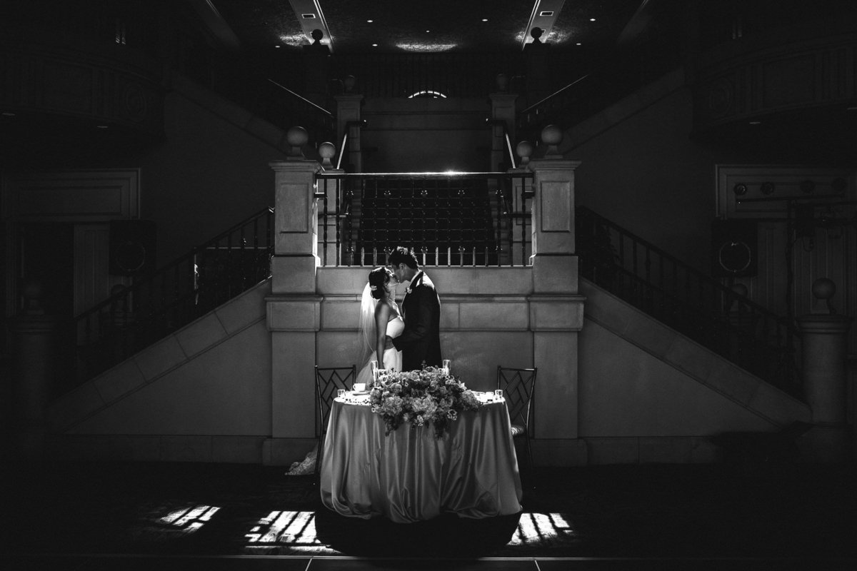 alice-che-photography-ruby-hill-golf-club-pleasonton-wedding-dramatic-couple-in-front-of-staircase-black-and-white