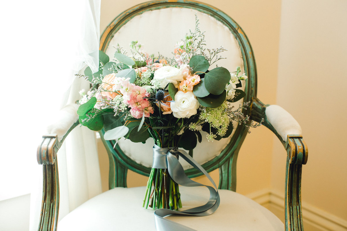 Bridal bouquet on vintage chair in bridal suite at Olympias Valley Estate in Petaluma California