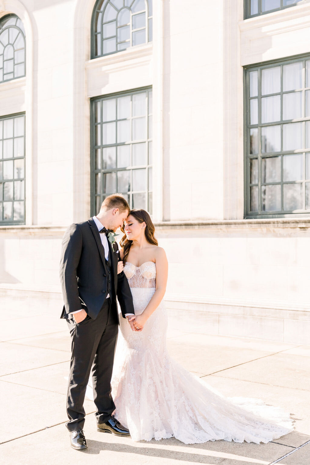 Bride and Groom photographed outside wedding  venue in Bowling Green, KY Paige Michelle Photography Light and Airy