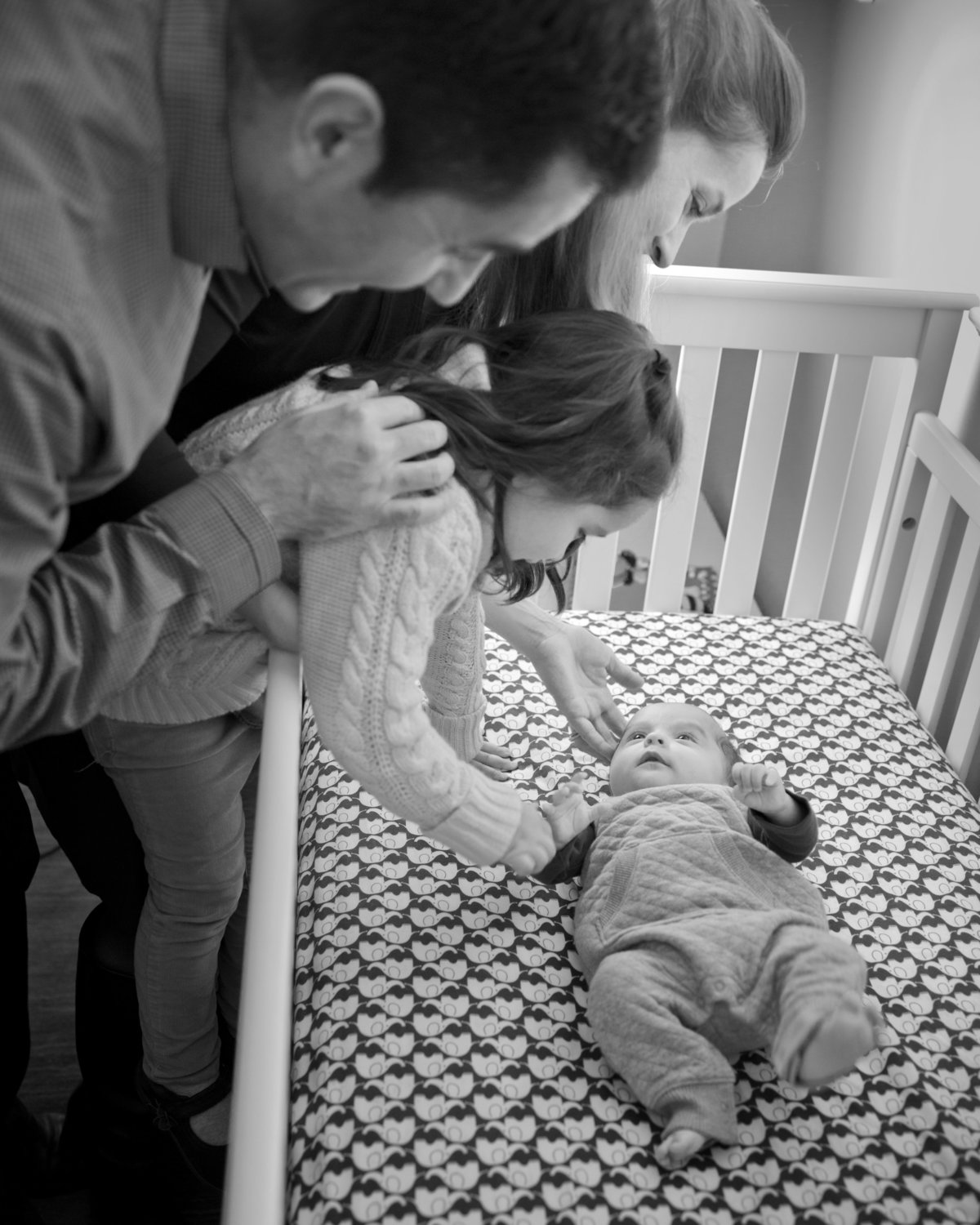Family welcomes newborn baby, lifestyle newborn photography, black and white newborn photographer, Alexandria, VA