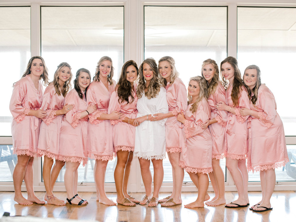 Bride and bridesmaids in matching pick robes
