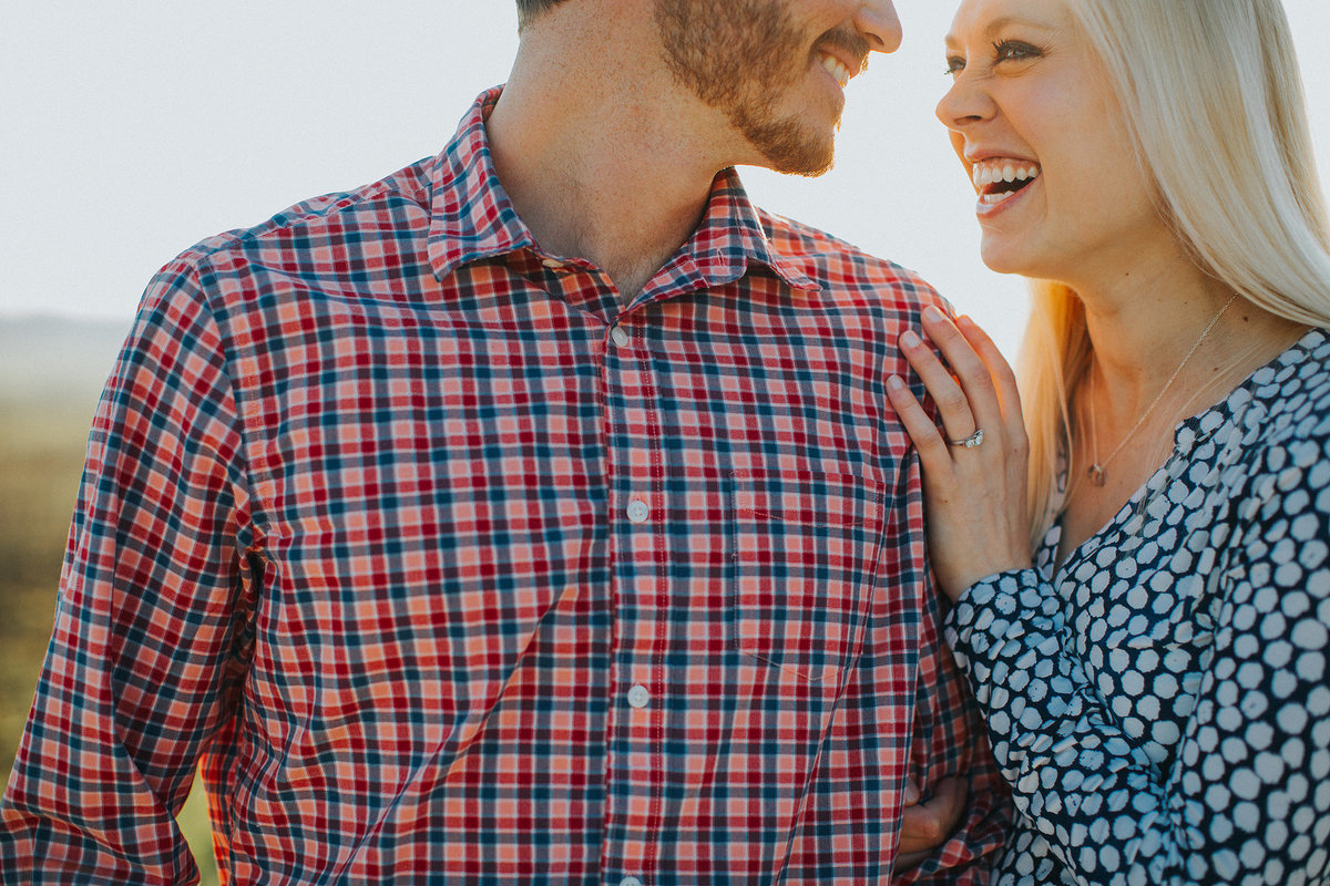 couple laughing together during their engagement photography session